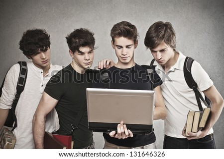 group of friends watching laptop together