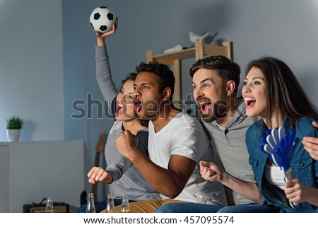 Group of friends watching sport together