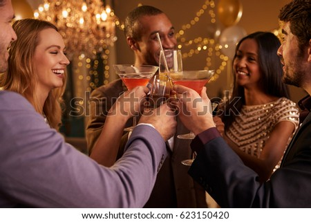 Group Of Friends With Drinks Enjoying Cocktail Party #623150420