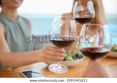 Group of friends with glasses of wine at table #1095945815