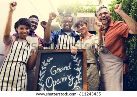 Group of friends with grand opening board together #611243435