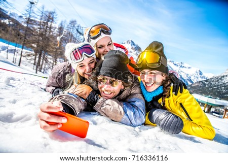 Group of friends with ski on winter holidays - Skiers having fun on the snow #716336116