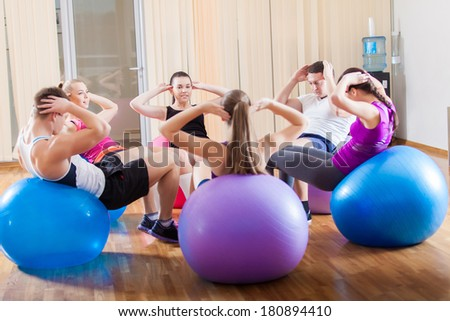 Group of friends working out at the fitness center
