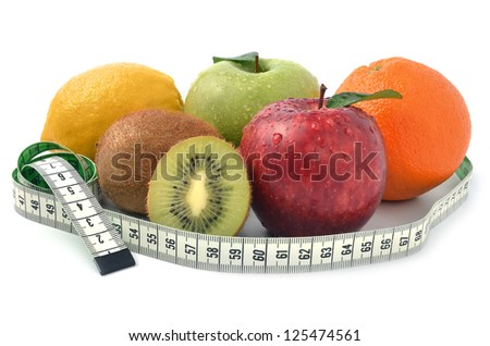 Group of fruits and measuring tape - concept