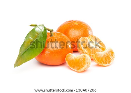 Group of fruits  with different names: Tangerine, mandarine or clementine. Full one and pieces. Isolated on white background.