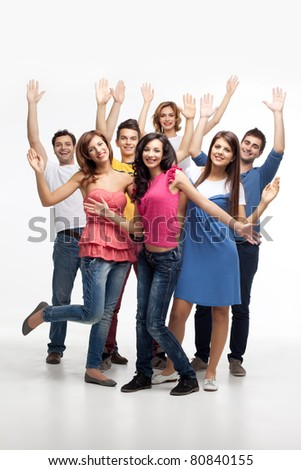 group of fun friends posing with hands in the air