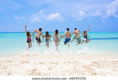 Group of fun-loving young adults playing in the beautiful ocean