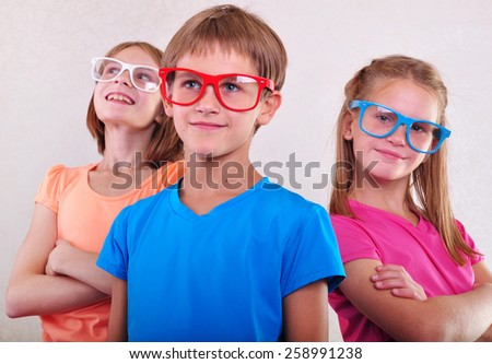 group of funny cute kids with eyeglasses posing
