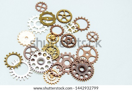 Group of gears on a light background. The background of the gears. #1442932799
