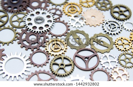 Group of gears on a light background. The background of the gears. #1442932802