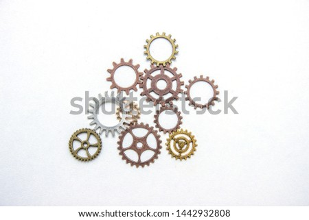 Group of gears on a light background. The background of the gears. #1442932808
