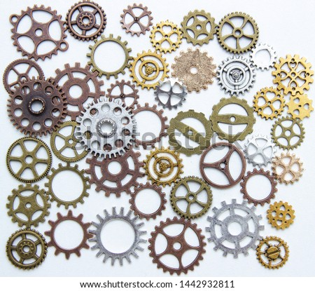 Group of gears on a light background. The background of the gears. #1442932811