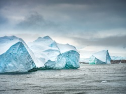 group of giant triangle icebergs in Antarctica