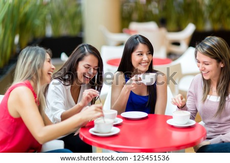 Group of girl friends meeting for coffee and talk