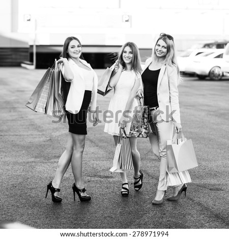 Group of girls after shopping on a parking