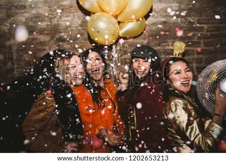 Group of girls celebrating and having fun the club. Concept about women night out #1202653213