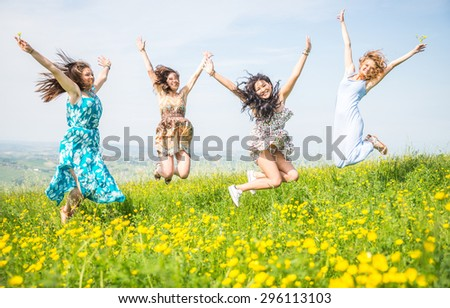 group of girls jumping in the nature. concept about women, youth, nature and people
