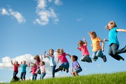 Group of Girls Jumping Together Outside - Unity, Friendship