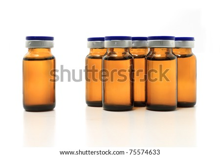 group of glass bottles with medicine on white background