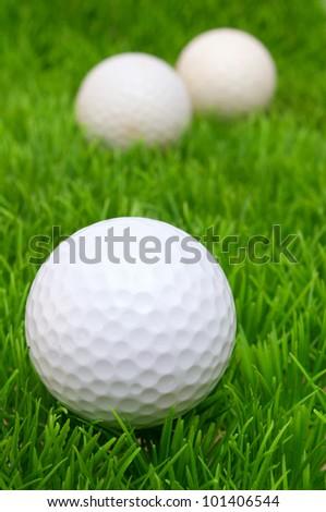 Group of Golf Balls in Green Grass