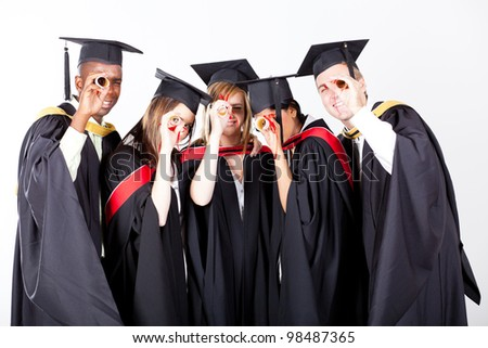 group of graduates looking through their diploma