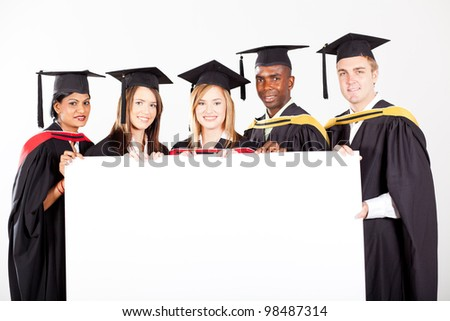group of graduates with white board - stock photo