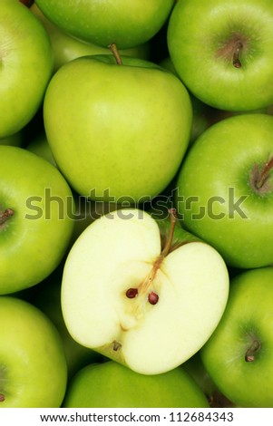 Group of green apples forming a background