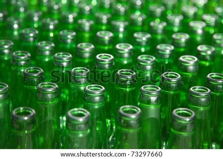 group of green glass bottles