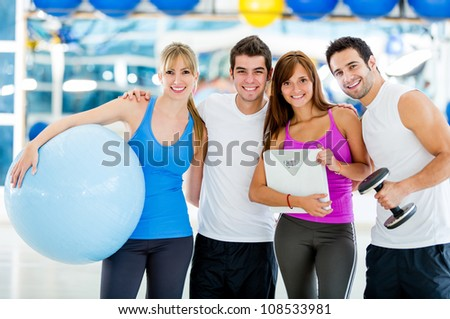 Group of gym people looking very happy