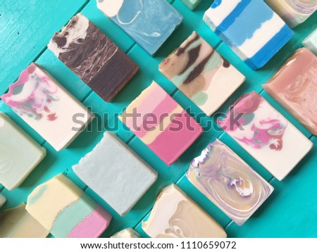 Group of handmade natural oil soap on green background.