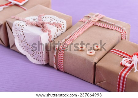 Group of handmade present boxes on purple background