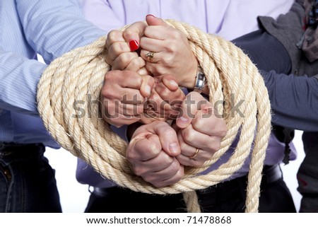 Group of hands arrested with a rope