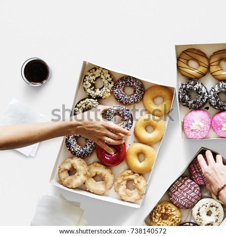 Group of hands holding sweeten donut dessert