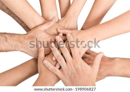 Group of hands holding together on white background.