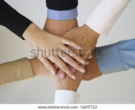 Group of hands together on top of each other.