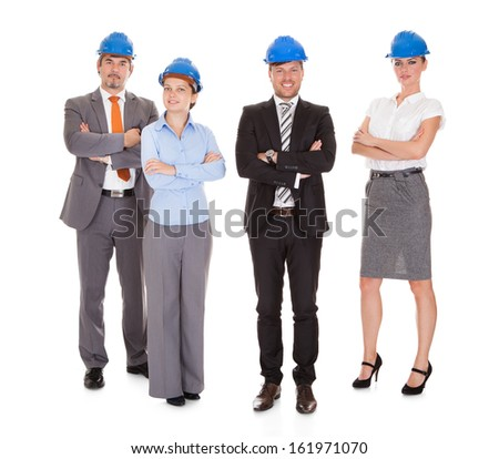 Group Of Happy Architects With Arm Crossed Over White Background