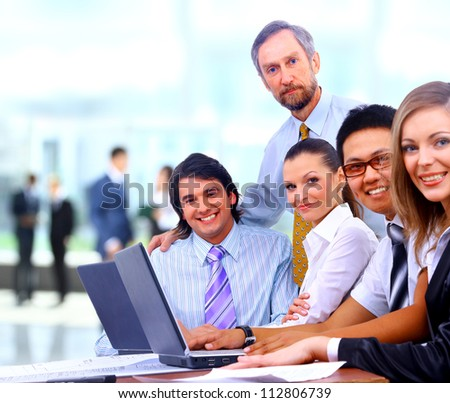 Group of happy business colleague in a meeting together at office