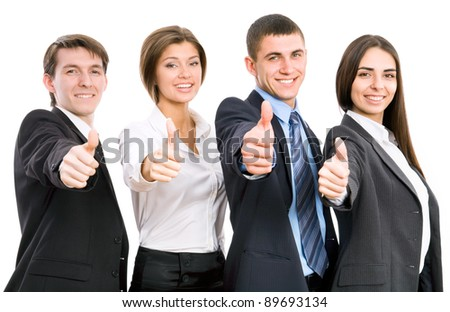 Group of happy business people giving the thumbs-up sign