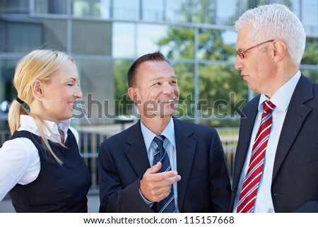 Group of happy business people having a meeting outside
