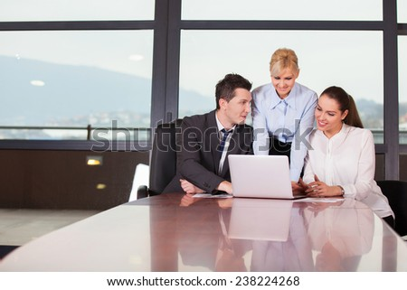 Group of happy business people in a meeting at modern office