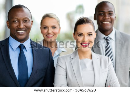 group of happy businesspeople in modern office #384569620