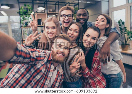 Group of happy cheerful best friends making selfie.