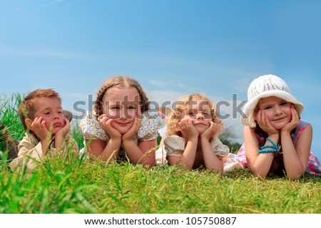 Group of happy children having a rest together outdoors. - stock photo
