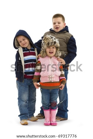 Group of 3 happy children posing together, smiling. Isolated on white background.?