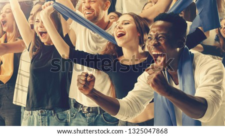 Group of happy fans are cheering for their team victory #1325047868