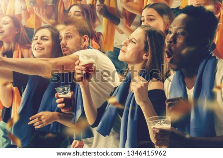 Group of happy fans are cheering for their team victory #1346415962