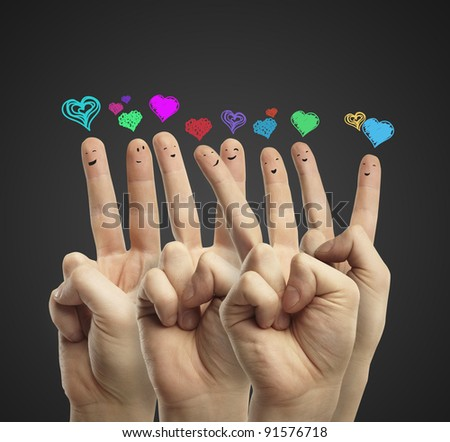 Group of happy finger smileys with love heart speech bubbles and social chat sign.