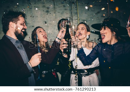 Shutterstock Group of happy friends drinking champagne and celebrating New Year. New year party. Birthday party