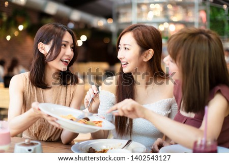 Group of Happy friends having dinner in the restaurant