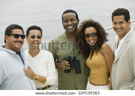 Group of happy friends on the yacht during vacation